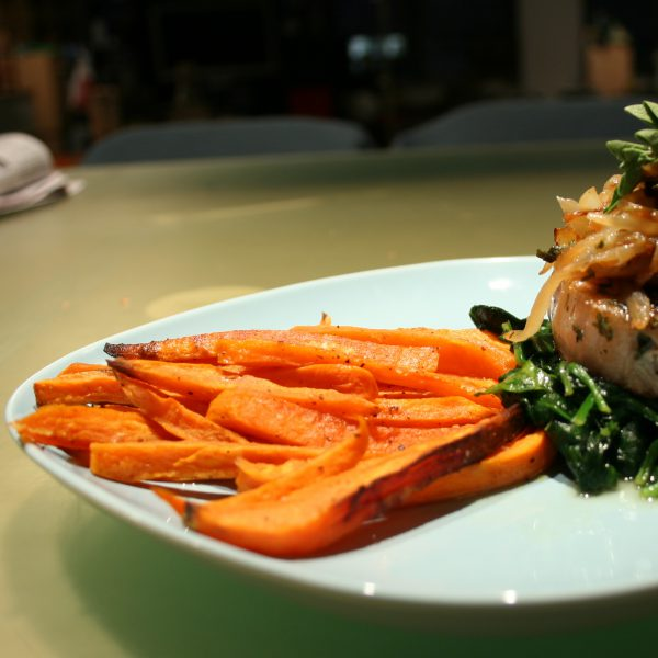 Kira Nam Greene Herb-encrusted Pork Chop with Spinach and Sweet Potato Oven Fries